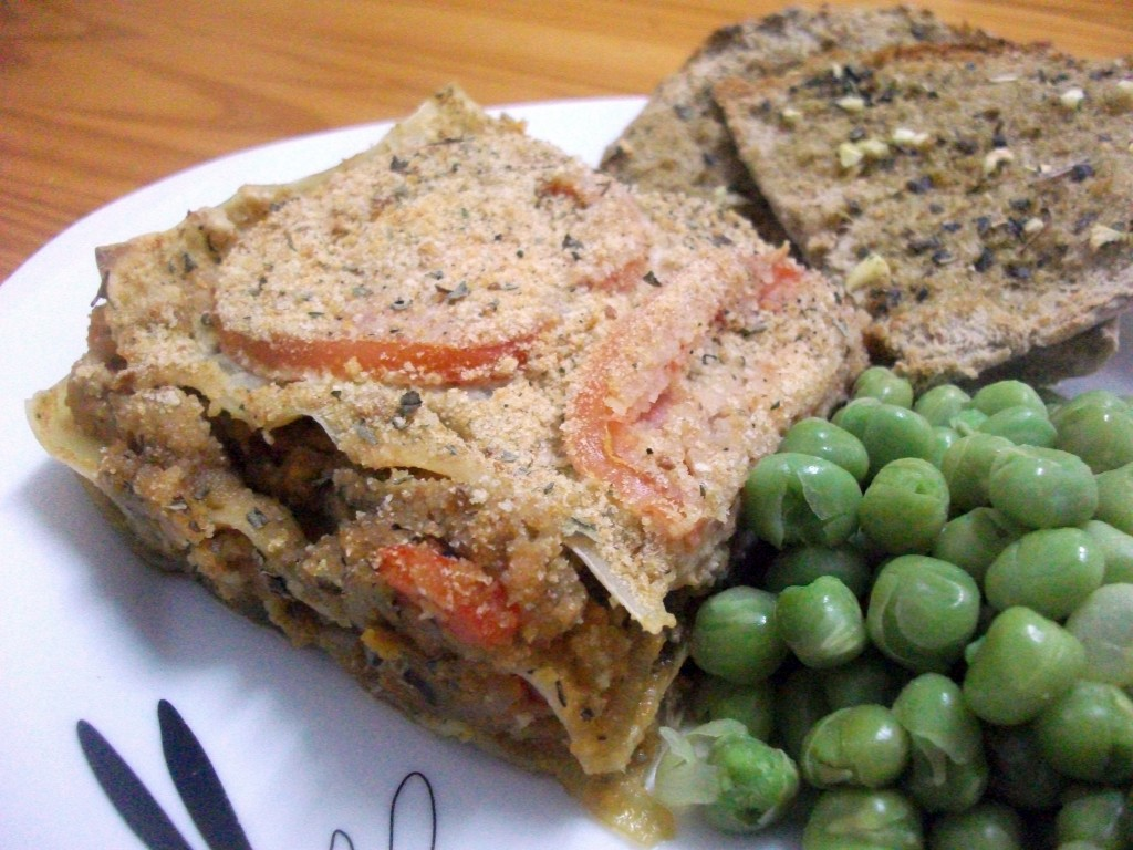 Vegan Lasagne served with a side of peas and garlic pitta breadThis Is ...