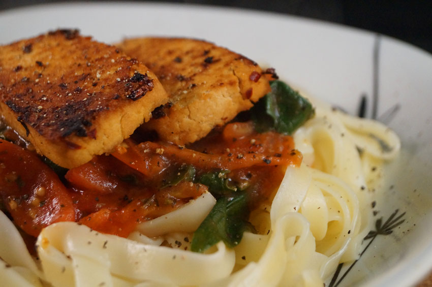 Tagliatelle with Balsamic & Chili Marinated Tofu Pan Seared and served with a Roasted Cherry Tomato & Spinach sm